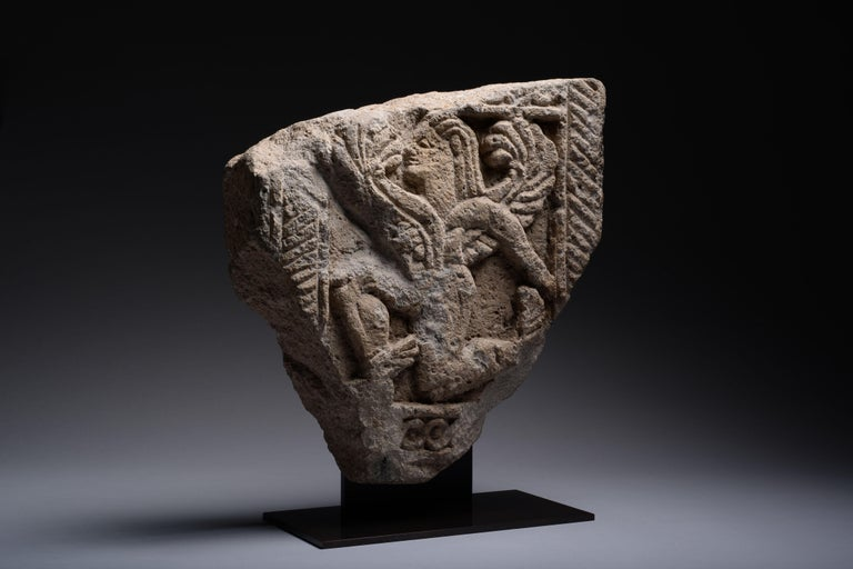 A fragment of Etruscan architecture depicting a winged god, circa 6th century BC.