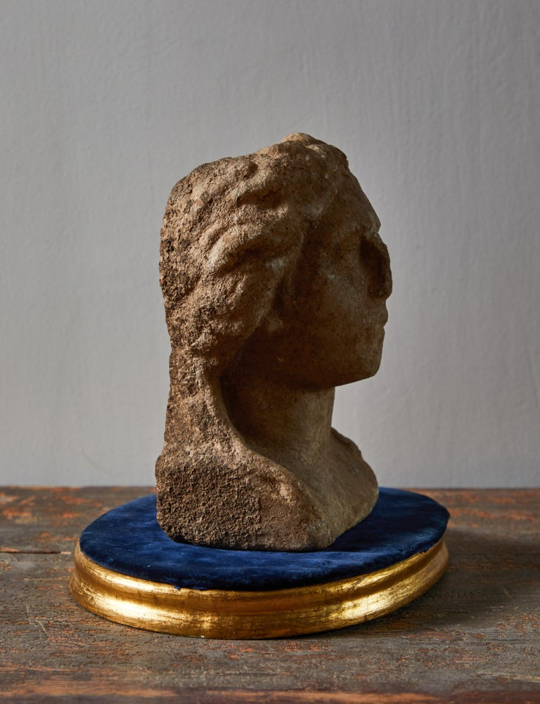 Limestone female bust with stand. Made in Greece circa 5th century AD.