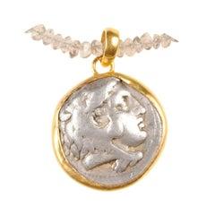 Ancient Greek Coin Artfully Set in 22-Karat Gold Drop Style