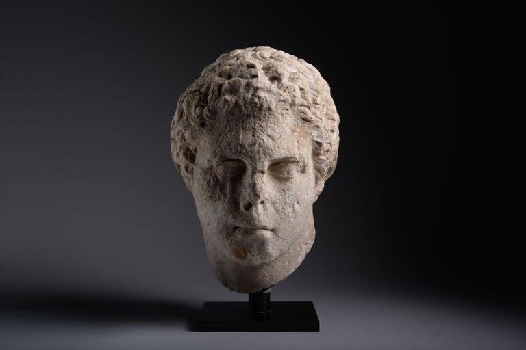 A Hellenistic over life-size marble head of an athlete, circa 300 BC.