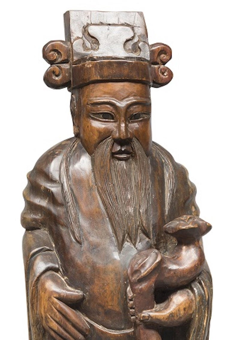 Chinese wood sculpture is an original decorative object realized in the end of the 19th century.