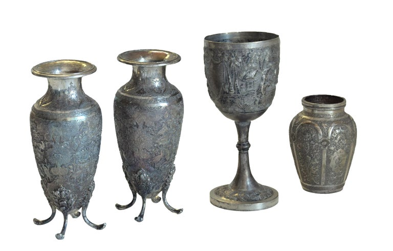 Persian chalice and vases is an original group of decorative objects realized in Persia in the mid-19th century.