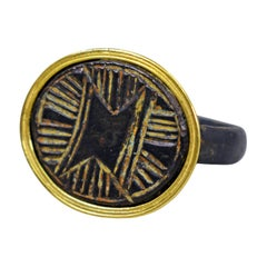 Ancient Roman Bronze Carved Signet Ring with 22 Karat Gold Bezel