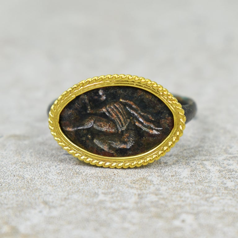 Classical Roman Ancient Roman Bronze Carved Signet Ring with 22 Karat Gold Rope Bezel For Sale