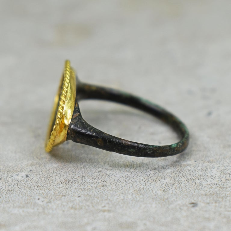 Ancient Roman Bronze Carved Signet Ring with 22 Karat Gold Rope Bezel In Good Condition For Sale In Naples, FL