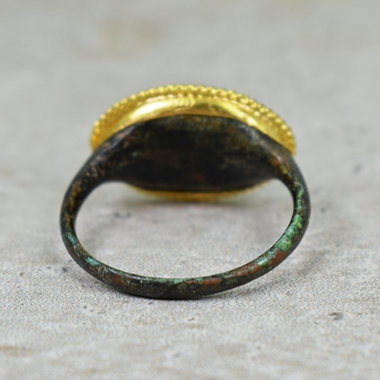 Women's or Men's Ancient Roman Bronze Carved Signet Ring with 22 Karat Gold Rope Bezel For Sale