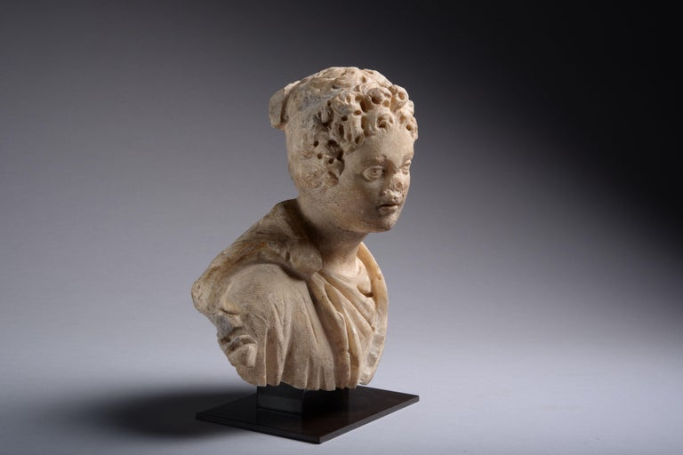 A Roman marble bust of a young man, circa 3rd century AD.
