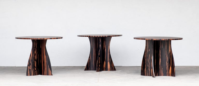 The Andino Side Table features two gently curving bentwood supports that appear different from every angle. Handmade in Costantini's family-owned workshop in Buenos Aires and available in any material or finish, and any size or shape top.