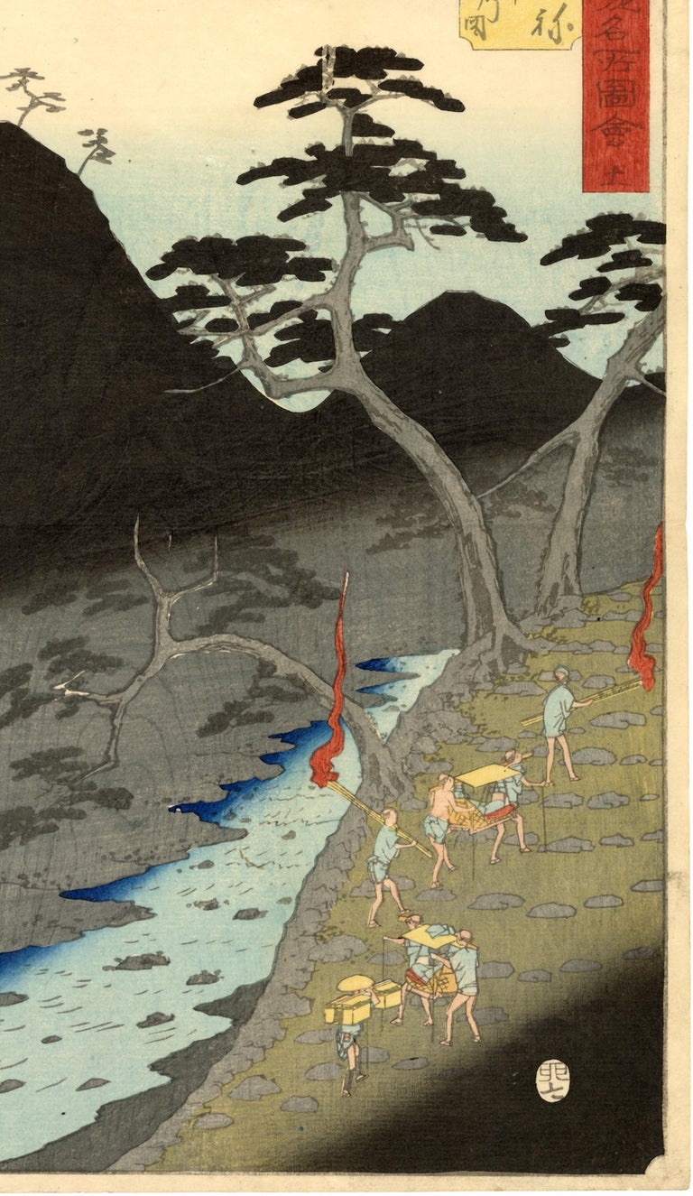 Station number 11 on the Tokaido Road, Hakone.  Station Hakone was known for its views and its steep terrain. Hiroshige has here chosen to depict the latter, as we see palanquin bearers taking the steep steps in a zigzag fashion. Two attendants
