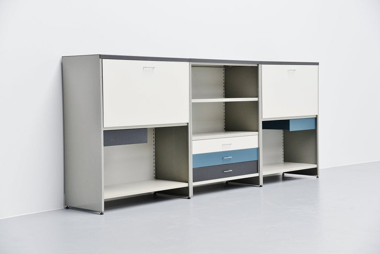 Very nice high sideboard from the famous 5600 modular series designed by Andre Cordemeijer and manufactured by Gispen Culemborg, The Netherlands, 1962. This sideboard is one of the many options we could build. It's a very nice, complete and