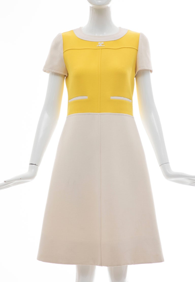 Andre Courreges, circa 1960's  yellow cream wool cap sleeve A-Line dress with back buttons and fully lined.