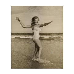 Marilyn Monroe playing on the Beach, 1949. A black and white portrait.
