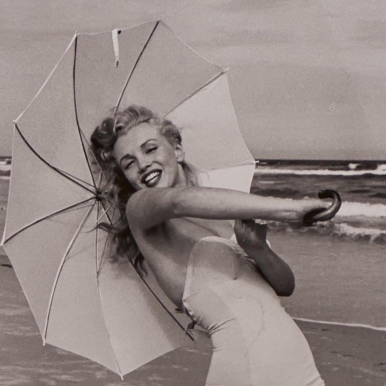 Marilyn Monroe 'Umbrella Girl on Beach' by André de Dienes - Black and White - Print by Andre de Dienes