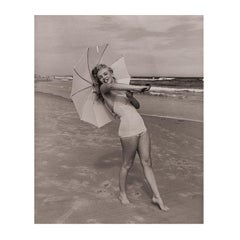 Marilyn Monroe 'Umbrella Girl on Beach' by André de Dienes - Black and White