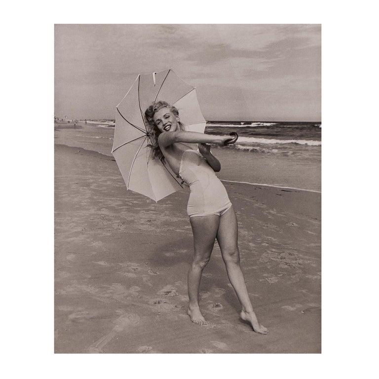 Andre de Dienes Portrait Print - Marilyn Monroe 'Umbrella Girl on Beach' by André de Dienes - Black and White