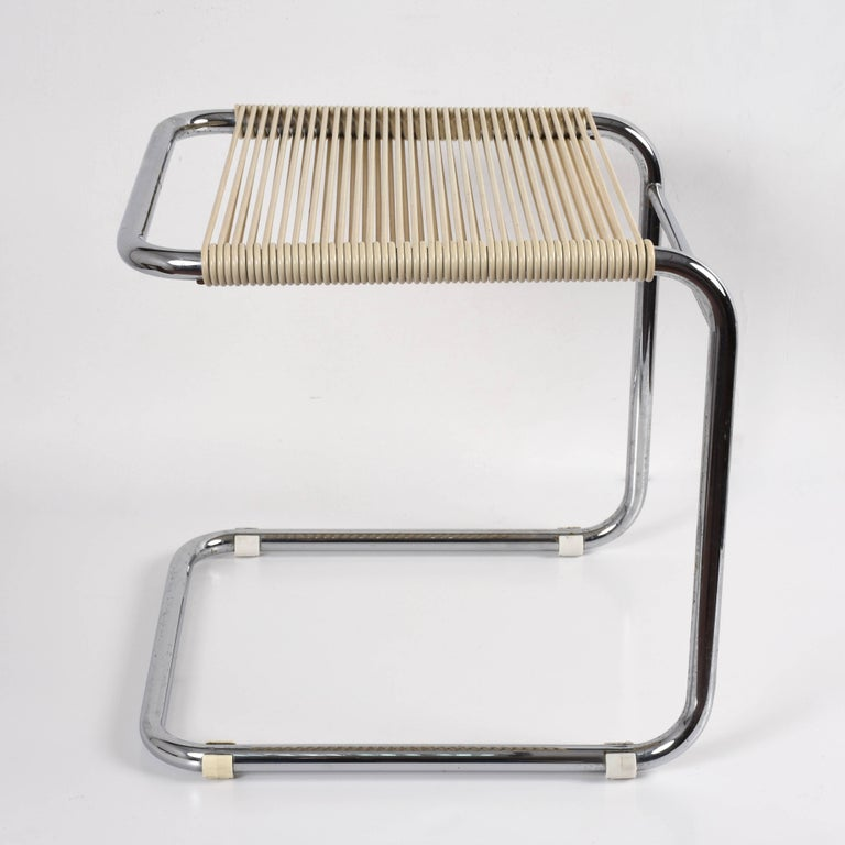 Wonderful midcentury chromed tubular steel and white plastic stool. This amazing item was designed by Andre Dupre and produced by Knoll during 1960s.  This polyhedric item could be used as a stool or ottoman and would look great in any room. Cool,