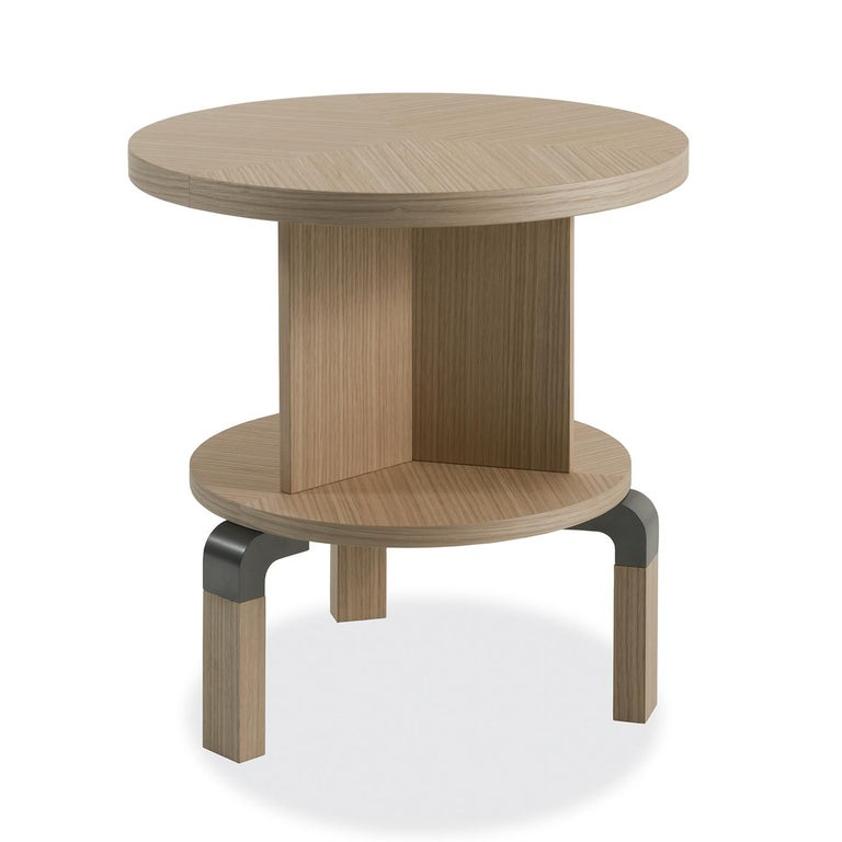 This stunning side table is part of the Andrè collection, featuring a dynamic silhouette combining curved elements and straight lines in a vertical TOTEM-like structure that creates a dynamic effect and provides two different display surfaces. The