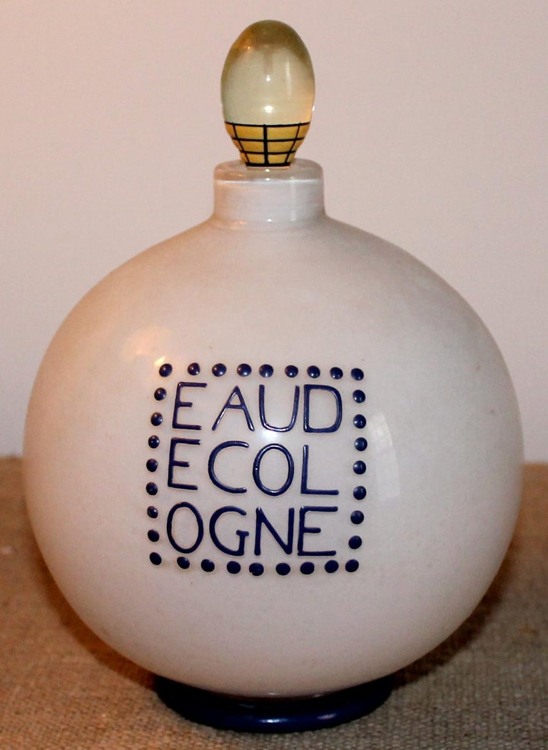 Designed by Andre Groult (1884-1966) for D;Orsay, a unique stoppered bottle hand enameled in indigo and signed with Groult's mark on the bottom. A round incased white under clear glass bottle, with the original glass stopper. Blue glass indigo foot.