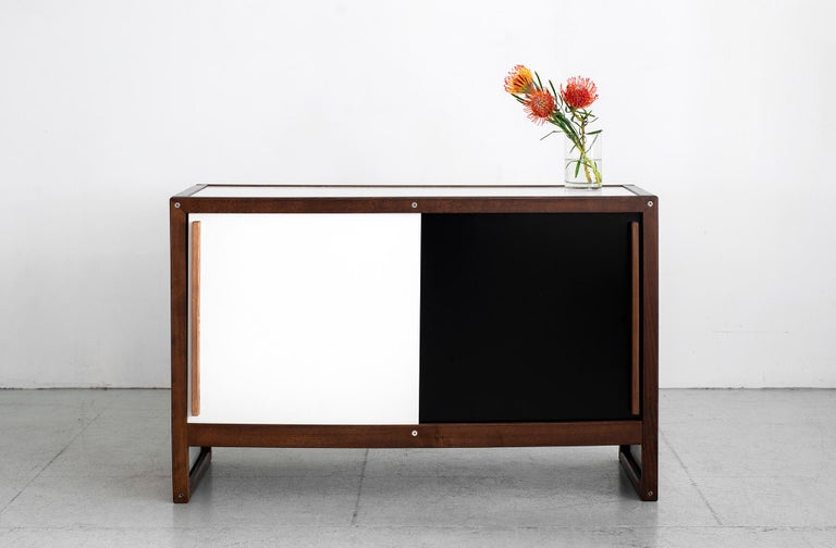Rare sideboard by French cabinetmaker André Sornay. Cabinet features classic black and white sliding doors on both sides framed in French oak. 