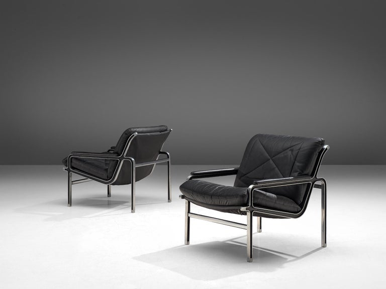 Andre Vandenbeuck for Straessle, pair of easy chairs, metal and leather, Switzerland, 1960s.