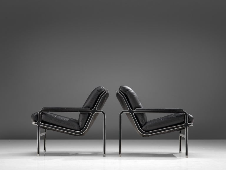Andre Vandenbeuck for Straessle, pair of easy chairs, metal, black leather, Switzerland, 1960s  These well-designed easy chairs are produced by Strassle in the 1960s. Functional and light appearance thanks to the combination of strong materials. A