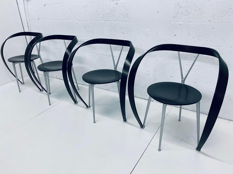 Ebony brown Revers dining chairs model 952 designed by Andrea Branzi for Cassina in 1993. These chairs were produced circa late 1990s. Sold individually.  The 952