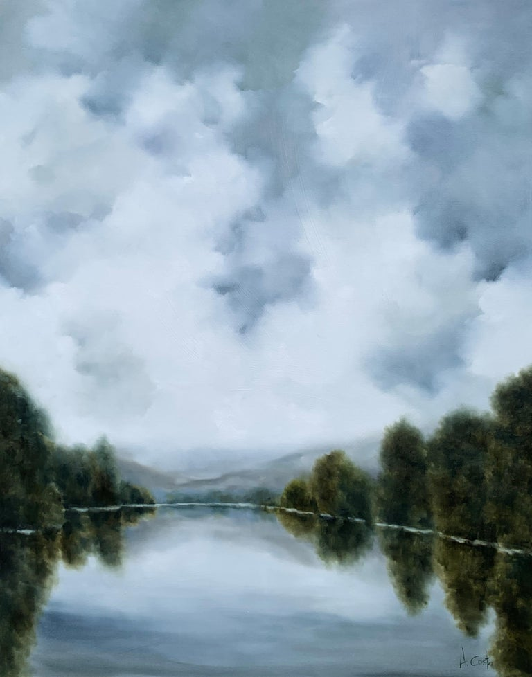 'Silver Lake' is a large Impressionist oil on gessoed canvas landscape painting created by American artist Andrea Costa in 2020. Featuring a soft palette mostly made of grey, white, blue and green tones, the painting depicts a peaceful and luminous