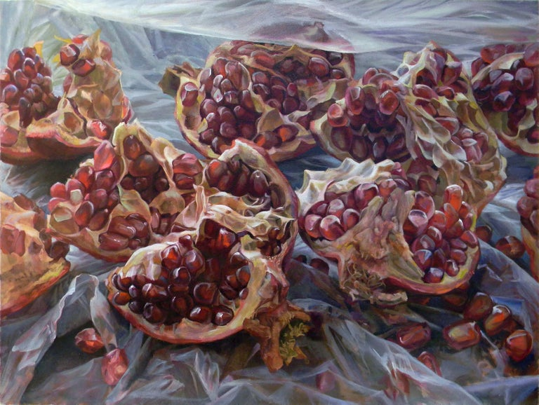 In this large, horizontal oil painting on canvas, bright burgundy and crimson red seeds spill out from inside an opened pomegranate, its sensuous form spread across a three panel composition. The rich, vibrant shades of rouge within the fruit are