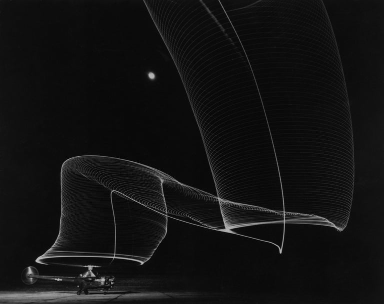 Navy Helicopter or Pattern Made by Helicopter Wing Lights, Anacostia, MD, 1949 - Photograph by Andreas Feininger