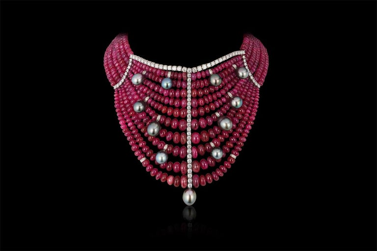 Andreoli Burma Ruby Cabochon Bead Tahitian Pearl Bib Necklace Diamond 18KT. This necklace features 850.74 carats of Burma Burmese Ruby cabochon beads with 11 Tahitian pearl drops weighing 20.00 grams. Outlined with 7.79 carats of round brilliant