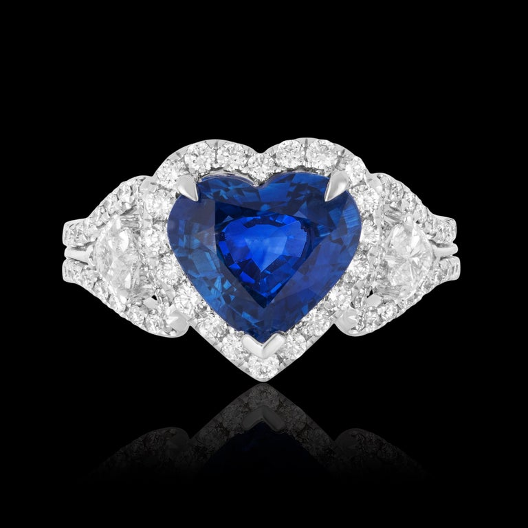 Andreoli CDC Certified 2.60 Carat Ceylon Blue Sapphire Diamond Heart Shape Ring  Features:  1.00 carat total weight of numerous near colourless round brilliant cut diamonds and two heart shape side diamonds. 2.60 carat Cornflower blue sapphire heart
