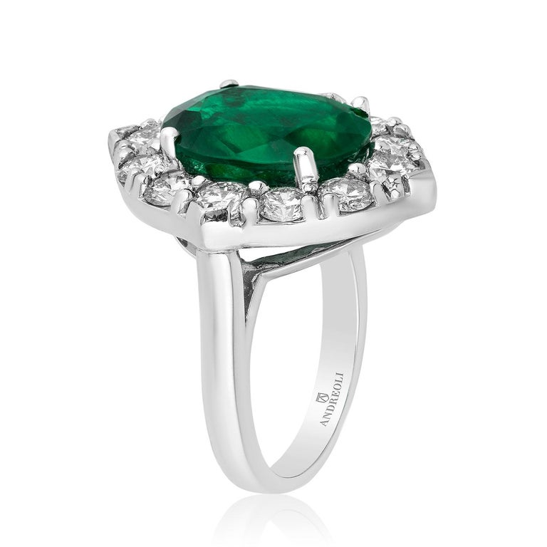 Andreoli CDC Certified No Oil 7.88 Carat Zambian Emerald Diamond Ring Platinum. Featuring a 7.88 carat vivid green Zambian oval Emerald no indications of clarity enhancement. Certified by CDC Switzerland. 2.44 carats of F-G-H Color VS-SI Clarity