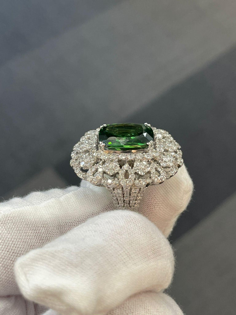 Andreoli Diamond and Peridot Cocktail Ring - Crafted in 18K white gold; centering a rectangular cushion-cut peridot weighing approximately 11.65 carats; accented by round brilliant-cut diamonds, weighing a total of approximately 3.25 carats, most