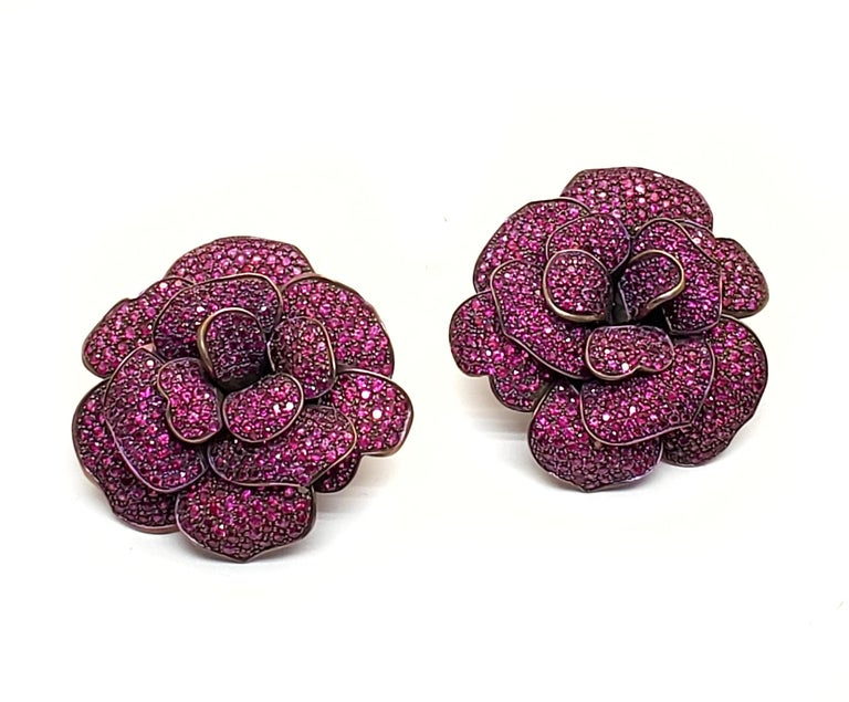 Andreoli Pink Sapphire Titanium Flower Clip On Earrings  Andreoli was one of the first jewelry creators to utilize titanium in high jewelry over 18KT or Platinum. The use of titanium allows for bigger and bolder designs without compromising on the