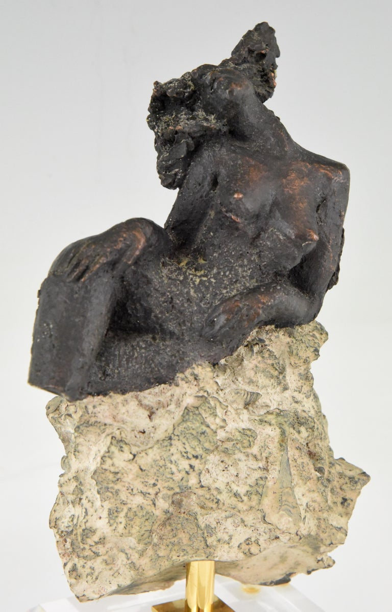 Modern sculpture of a nude on a rock signed and numbered by Andres Peralta, a Spanish artist, circa 1980.
