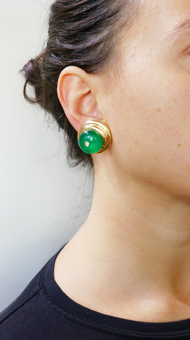 Bold and colorful set consisting of a pair of earrings and a pendant created by Andrew Clunn in the 1980s. Elegant, chic and wearable, the set a great addition to your jewelry collection.  Made of 18 karat (stamped) yellow gold and chrysoprase