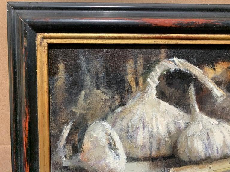 Modern British, Still life of garlic on a kitchen table in an interior. - Black Still-Life Painting by Andrew Davis