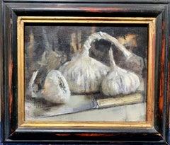 Modern British, Still life of garlic on a kitchen table in an interior.