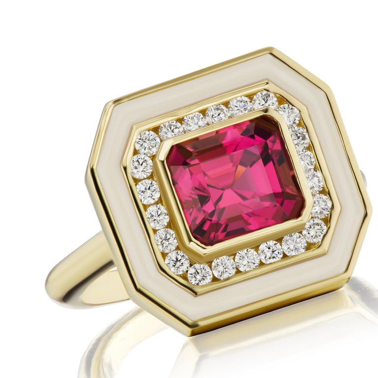A beautiful 2.12 carat Redish-Pink Asscher cut Tourmaline. It is a mesmerizing stone that has been set and surrounded by .33 ctw of GH VSI Diamonds, followed by a border of cream colored enamel. This ring is set in 18K Yellow Gold and is a size 7.