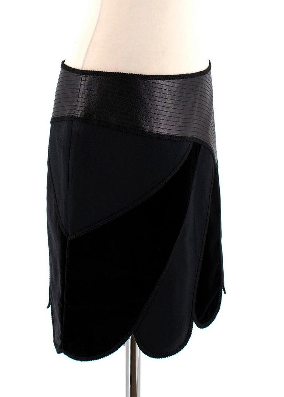 Andrew GN Black Contrast Panelled Scallop Hem Mini Skirt  - Black contrast panelled skirt  - Asymmetric design - Leather embossed trim  - Velvet and neoprene striped contrast detailing  - Scalloped hem  - Concealed side zip fastening  - Mini length