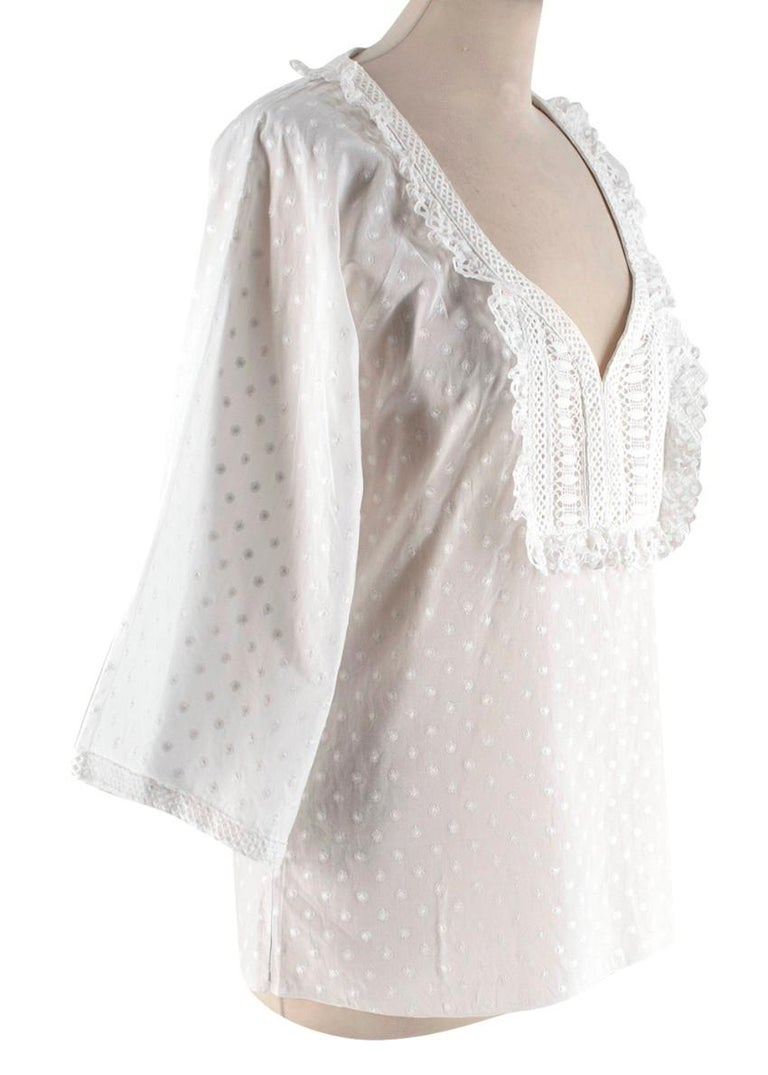 Andrew GN White Top With Frill Detail   - Sweetheart neckline - Frill detail on neckline  - Wide sleeves  - Embroidered white flower pattern all over   Materials: - 100% Cotton   Dry clean only   Made in France  Measurements are taken laying flat,