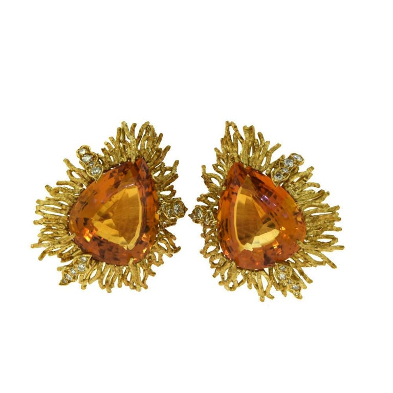 Brilliance Jewels, Miami Questions? Call Us Anytime! 786,482,8100  Designer: Andrew Grima  Hallmark: GRIMA, 18K  BROOCH  Metal: 18k Yellow Gold  Stones: 1 Lg. Pear Shape Citrine                    27 Round Brilliant Diamonds  Total Item Weight
