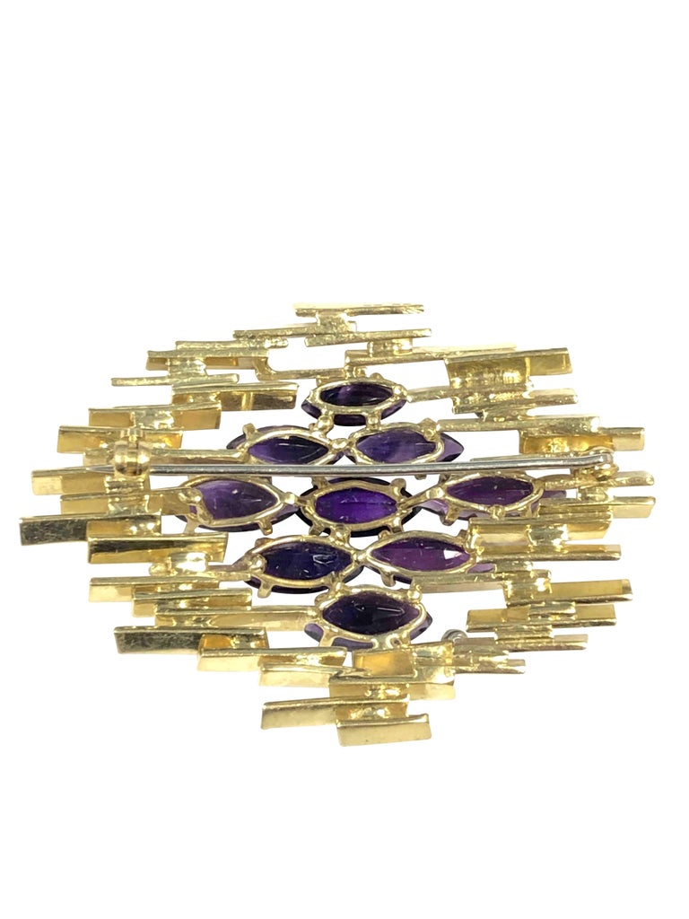 Circa 1970 Alan Martin Gard  leading British designer 18K Yellow Gold Brooch, measuring 2 1/4 X 1 5/8 inch, set with Gem Color Marquise shape Amethysts and Round brilliant cut Diamonds.