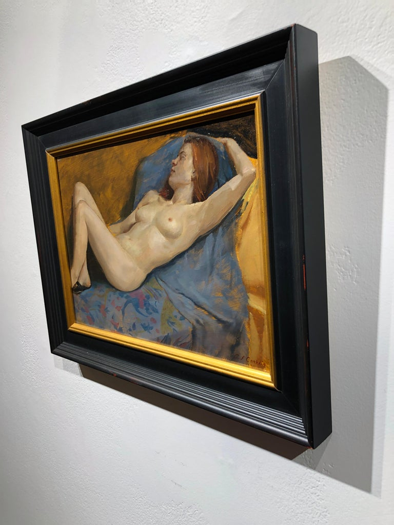 This classically painted nude model study demonstrates the artists understanding of the human figure.  Surrounded by loosely painted lush fabrics, the model lies in a reclining position, her eyes closed, wearing only a pair of slippers.  The quick,