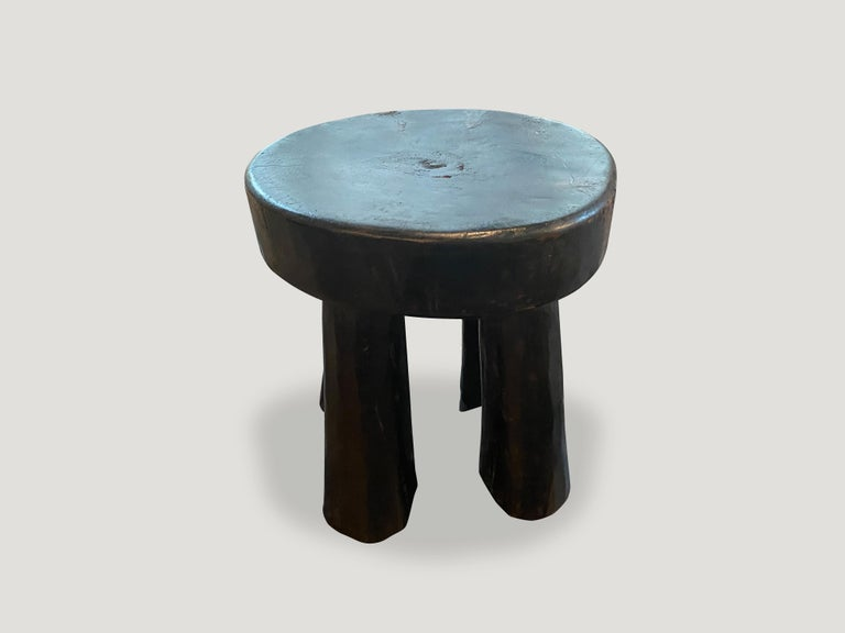 Hand carved African wood side table or stool.  This side table or stool was sourced in the spirit of wabi-sabi, a Japanese philosophy that beauty can be found in imperfection and impermanence. It is a beauty of things modest and humble. A beauty