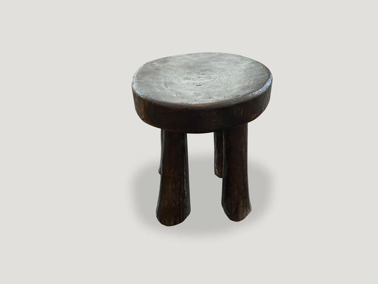 Hand carved African side table or stool.  This side table or stool was sourced in the spirit of wabi-sabi, a Japanese philosophy that beauty can be found in imperfection and impermanence. It is a beauty of things modest and humble. A beauty of