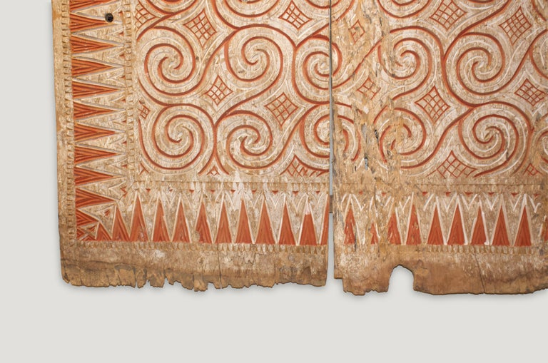 Beautiful hand carved ancient panel from Toraja, Sulawesi. Symbolizes peace and happiness. Measures: 56