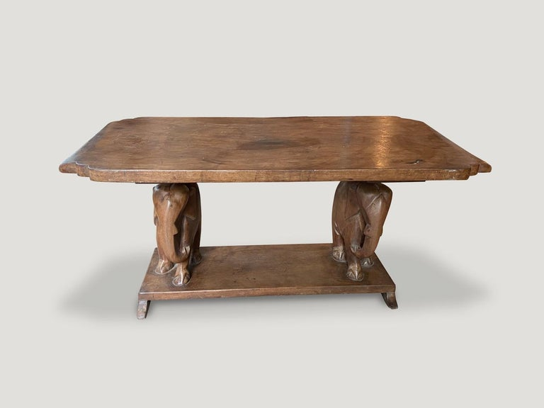 Whimsical coffee table from West Africa. Handmade from a single carved mahogany wood top with a hand carved elephant base.  This coffee table was sourced in the spirit of wabi-sabi, a Japanese philosophy that beauty can be found in imperfection