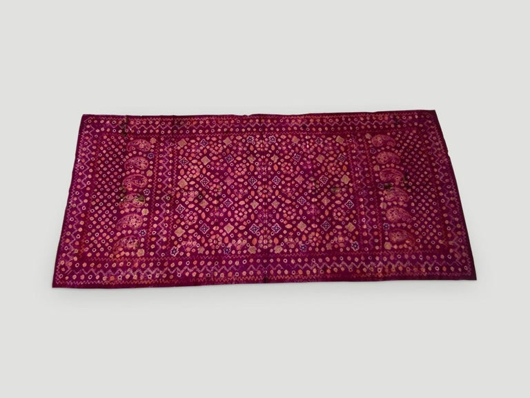 Stunning contrasting colors on this beautiful fine silk, tie dye ceremonial shoulder cloth from Palembang, Sumatra. Early 20 century.  This beautiful shawl can be worn or used as a wall hanging framed. We only source the best.   Andrianna