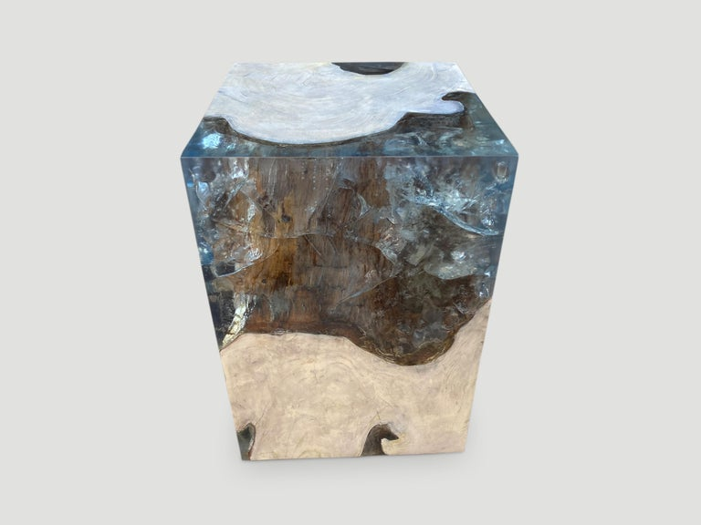 The St. Barts side table is a unique variation of the teak and cracked resin cube. Ice blue, aqua resin or new to 2021 deep sea blue resin, is cracked and added into the natural grooves of the bleached teak wood and finally sanded and finished with